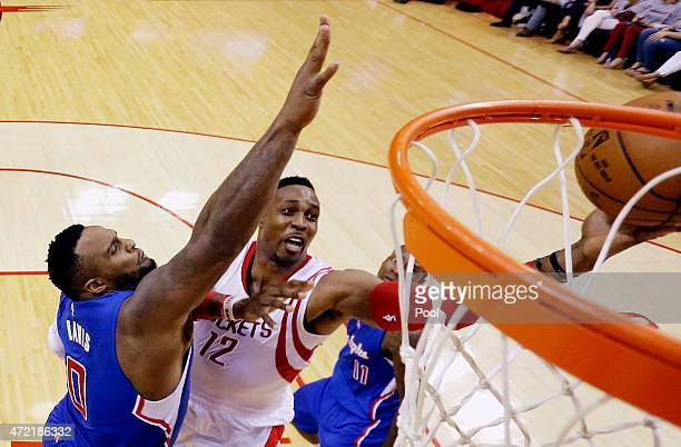 Dwight Howard of the Houston Rockets takes a shot over Glen Davis of the Los Angeles Clippers during Game One in the Western Conference Semifinals of...