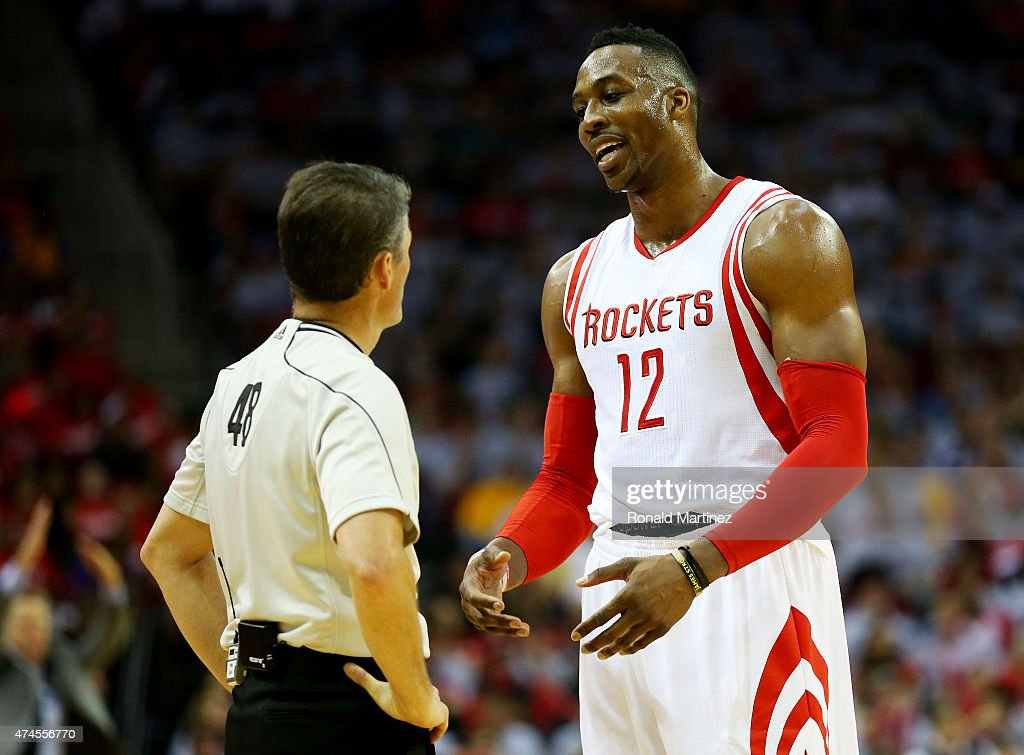 Dwight Howard of the Houston Rockets talks to referee Scott Foster in the second quarter against the Golden State Warriors during Game Three of the...