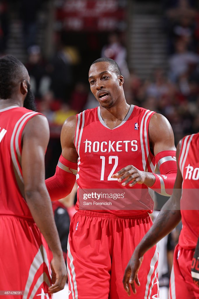 <a gi-track='captionPersonalityLinkClicked' href=/galleries/search?phrase=Dwight+Howard&family=editorial&specificpeople=201570 ng-click='$event.stopPropagation()'>Dwight Howard</a> #12 of the Houston Rockets walks off the court against the Portland Trail Blazers on November 5, 2013 at the Moda Center Arena in Portland, Oregon.
