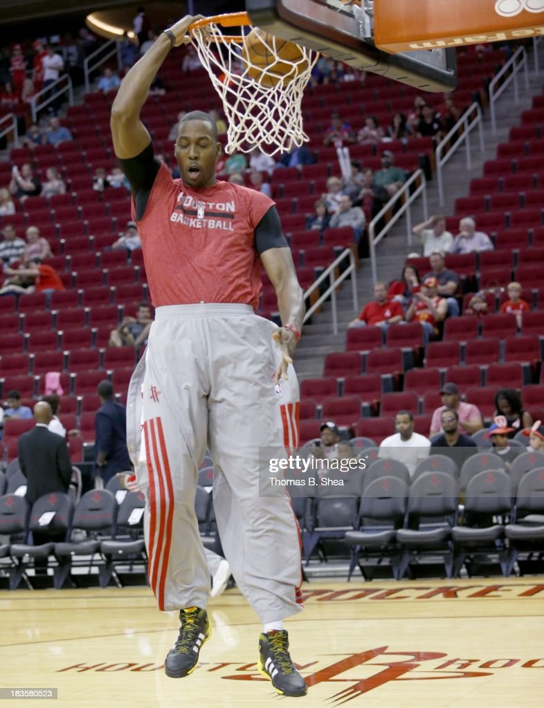 Dwight Howard #12 of the Houston Rockets warms up before playing against the New Orleans Pelicans in a preseason NBA game on October 5, 2013 at Toyota Center in Houston, Texas. The Pelicans won 116 to 115.