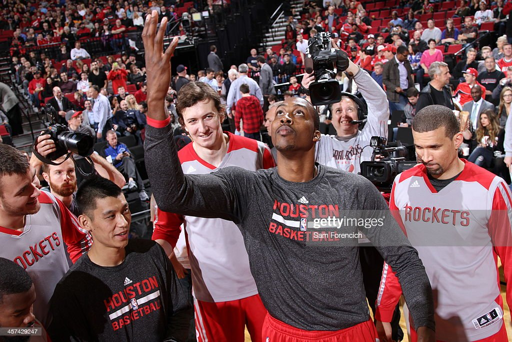 <a gi-track='captionPersonalityLinkClicked' href=/galleries/search?phrase=Dwight+Howard&family=editorial&specificpeople=201570 ng-click='$event.stopPropagation()'>Dwight Howard</a> #12 of the Houston Rockets warms up before the game against the Portland Trail Blazers on November 5, 2013 at the Moda Center Arena in Portland, Oregon.