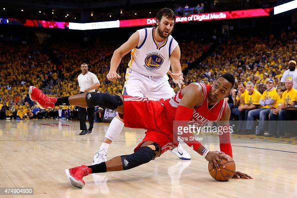 Dwight Howard of the Houston Rockets with the ball on the ground in front of Andrew Bogut of the Golden State Warriors in the second half during game...