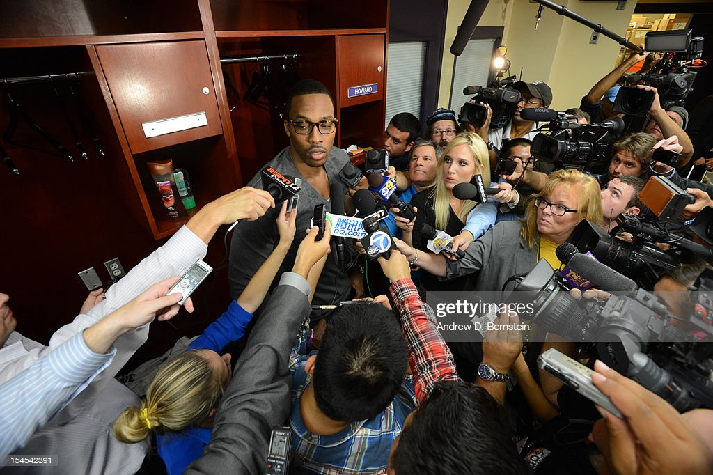 <a gi-track='captionPersonalityLinkClicked' href=/galleries/search?phrase=Dwight+Howard&family=editorial&specificpeople=201570 ng-click='$event.stopPropagation()'>Dwight Howard</a> #12 of the Los Angeles Lakers answers questions following his team's loss to the Sacramento Kings during a pre-season game at Staples Center on October 21, 2012 in Los Angeles, California.