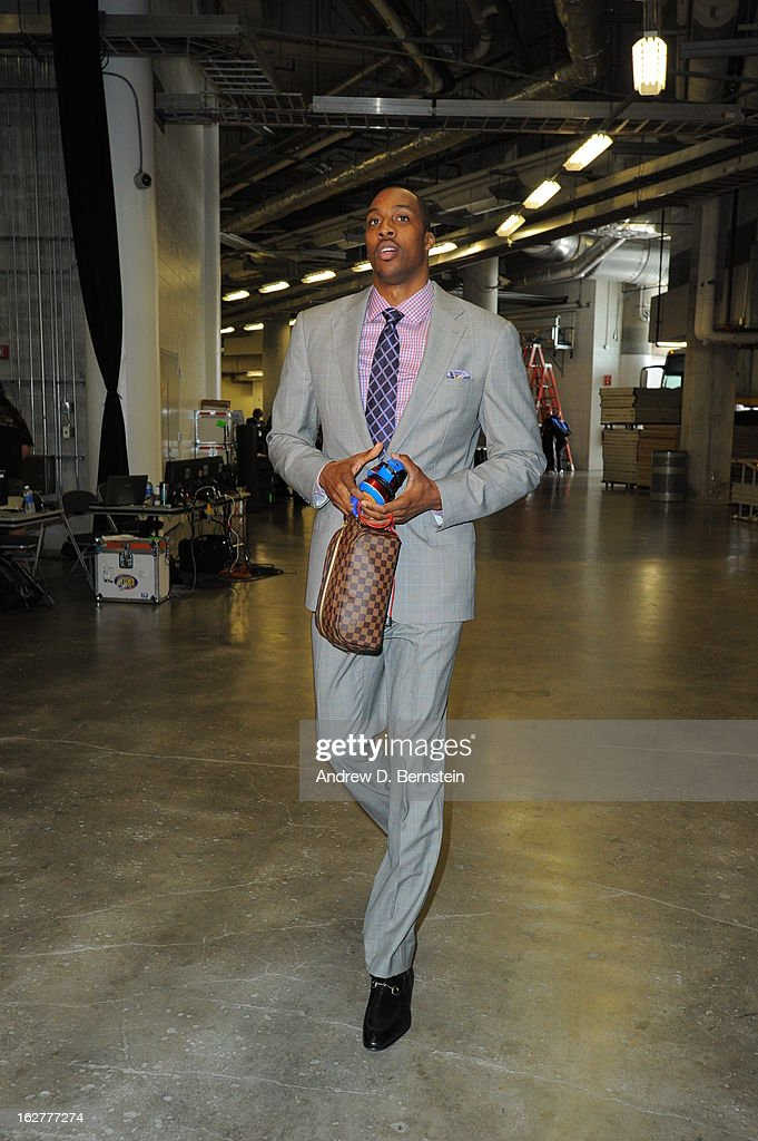 Dwight Howard #12 of the Los Angeles Lakers arrives before the game against the Miami Heat on February 10, 2013 at American Airlines Arena in Miami, Florida.