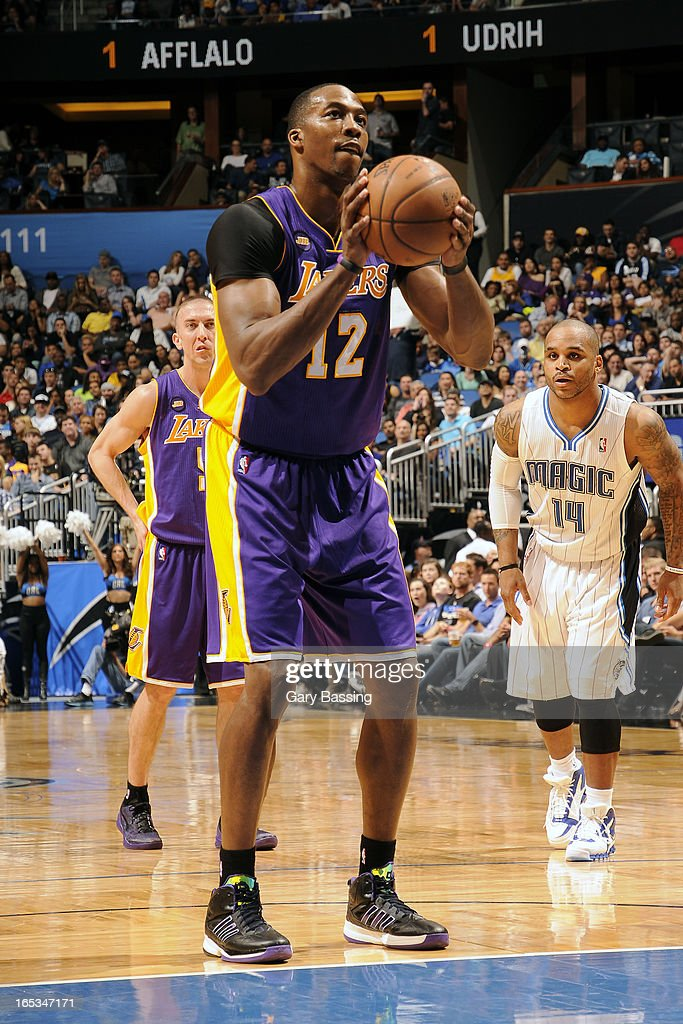 <a gi-track='captionPersonalityLinkClicked' href=/galleries/search?phrase=Dwight+Howard&family=editorial&specificpeople=201570 ng-click='$event.stopPropagation()'>Dwight Howard</a> #12 of the Los Angeles Lakers attempts a foul shot against the Orlando Magic on March 12, 2013 at Amway Center in Orlando, Florida.