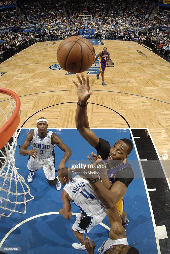 Dwight Howard #12 of the Los Angeles Lakers attempts that bucket against the Orlando Magic during the game on March 12, 2013 at Amway Center in Orlando, Florida.