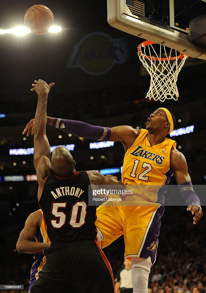 Dwight Howard #12 of the Los Angeles Lakers blocks a shot by Joel Anthony #50 of the Miami Heat at Staples Center on January 17, 2013 in Los Angeles, California.