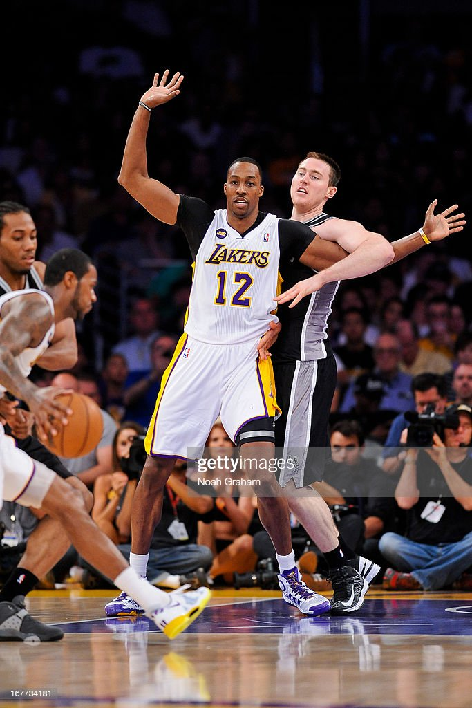 Dwight Howard #12 of the Los Angeles Lakers calls for the ball against Aron Baynes #16 of the San Antonio Spurs in Game Four of the Western Conference Quarterfinals during the 2013 NBA Playoffs at Staples Center on April 28, 2013 in Los Angeles, California.