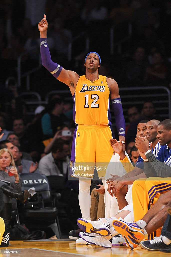 Dwight Howard #12 of the Los Angeles Lakers celebrates from the sideline during a game against the Utah Jazz at Staples Center on January 25, 2013 in Los Angeles, California.