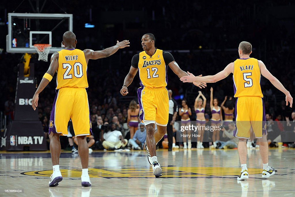 Dwight Howard #12 of the Los Angeles Lakers celebrates his basket with Jodie Meeks #20 and Steve Blake #5 during a 116-94 Laker win over the Minnesota Timberwolves at Staples Center on February 28, 2013 in Los Angeles, California.