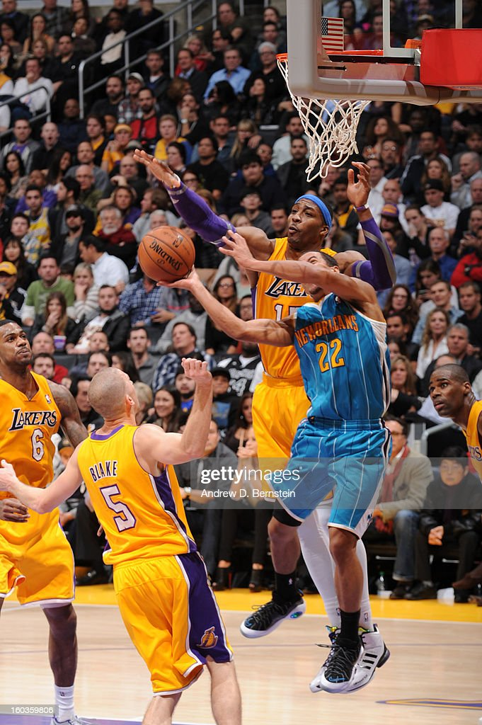 Dwight Howard #12 of the Los Angeles Lakers challenges the shot of Brian Roberts #22 of the New Orleans Hornets at Staples Center on January 29, 2013 in Los Angeles, California.