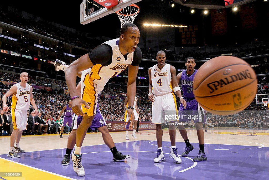 <a gi-track='captionPersonalityLinkClicked' href=/galleries/search?phrase=Dwight+Howard&family=editorial&specificpeople=201570 ng-click='$event.stopPropagation()'>Dwight Howard</a> #12 of the Los Angeles Lakers chases after a loose ball against the Sacramento Kings at Staples Center on March 17, 2013 in Los Angeles, California.