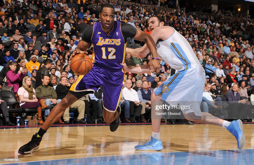 Dwight Howard #12 of the Los Angeles Lakers drives against Kosta Koufos #41 of the Denver Nuggets on February 25, 2013 at the Pepsi Center in Denver, Colorado.