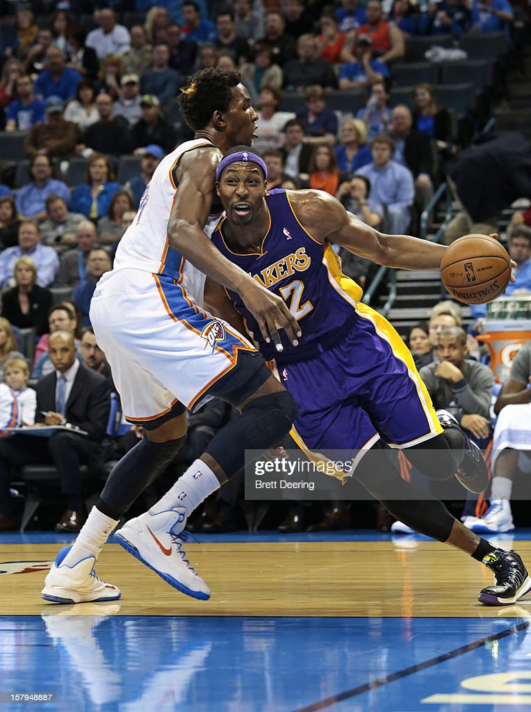 <a gi-track='captionPersonalityLinkClicked' href=/galleries/search?phrase=Dwight+Howard&family=editorial&specificpeople=201570 ng-click='$event.stopPropagation()'>Dwight Howard</a> #12 of the Los Angeles Lakers drives the baseline on <a gi-track='captionPersonalityLinkClicked' href=/galleries/search?phrase=Hasheem+Thabeet&family=editorial&specificpeople=4003778 ng-click='$event.stopPropagation()'>Hasheem Thabeet</a> #34 of the Oklahoma City Thunder December 7, 2012 at Chesapeake Energy Arena in Oklahoma City, Oklahoma. Oklahoma City defeated Los Angeles 114-108.