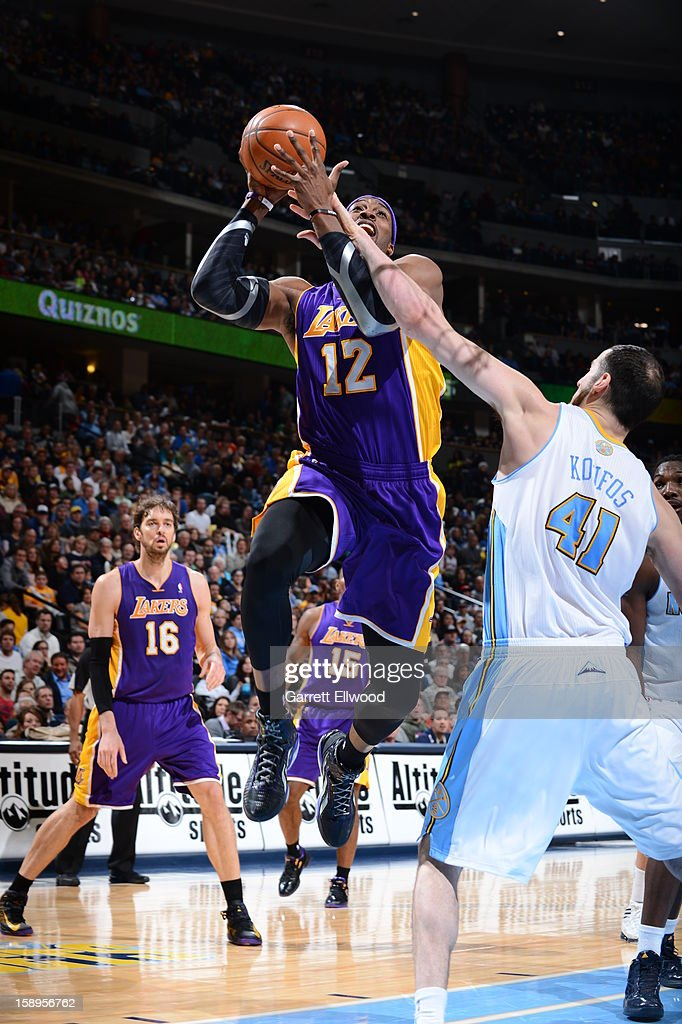 <a gi-track='captionPersonalityLinkClicked' href=/galleries/search?phrase=Dwight+Howard&family=editorial&specificpeople=201570 ng-click='$event.stopPropagation()'>Dwight Howard</a> #12 of the Los Angeles Lakers drives to the basket against the Denver Nuggets on December 26, 2012 at the Pepsi Center in Denver, Colorado.