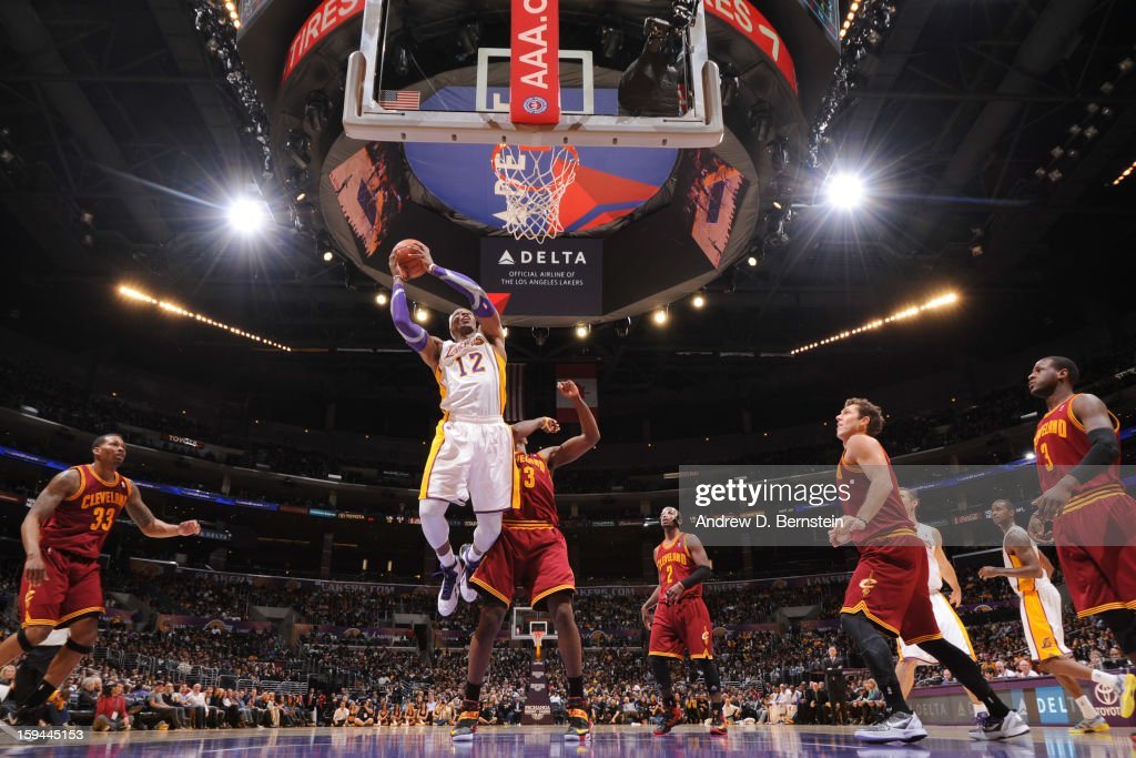 Dwight Howard #12 of the Los Angeles Lakers drives to the basket against the Cleveland Cavaliers at Staples Center on January 13, 2013 in Los Angeles, California.