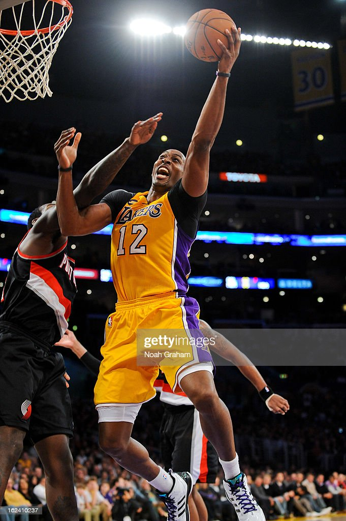 <a gi-track='captionPersonalityLinkClicked' href=/galleries/search?phrase=Dwight+Howard&family=editorial&specificpeople=201570 ng-click='$event.stopPropagation()'>Dwight Howard</a> #12 of the Los Angeles Lakers drives to the basket against the Portland Trail Blazers at Staples Center on February 22, 2013 in Los Angeles, California.