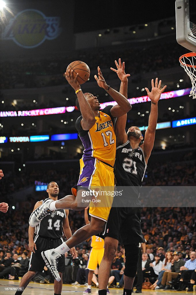 <a gi-track='captionPersonalityLinkClicked' href=/galleries/search?phrase=Dwight+Howard&family=editorial&specificpeople=201570 ng-click='$event.stopPropagation()'>Dwight Howard</a> #12 of the Los Angeles Lakers drives to the basket against the San Antonio Spurs at Staples Center in Game Three of the Western Conference Quarterfinals during the 2013 NBA Playoffs on April 26, 2013 in Los Angeles, California.