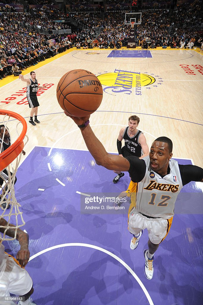 <a gi-track='captionPersonalityLinkClicked' href=/galleries/search?phrase=Dwight+Howard&family=editorial&specificpeople=201570 ng-click='$event.stopPropagation()'>Dwight Howard</a> #12 of the Los Angeles Lakers drives to the basket against the San Antonio Spurs at Staples Center on April 14, 2013 in Los Angeles, California.