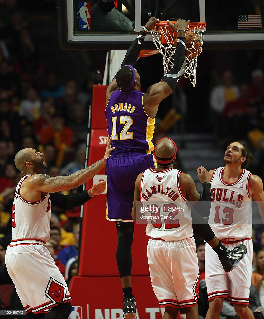 Dwight Howard #12 of the Los Angeles Lakers dunks against (L-R) Carlos Boozer #5, Richard Hamilton #32 and Joakim Noah #13 of the Chicago Bulls at the United Center on January 21, 2013 in Chicago, Illinois. The Bulls defeated the Lakers 95-83.
