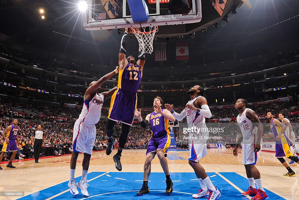 Dwight Howard #12 of the Los Angeles Lakers dunks against Lamar Odom #7 of the Los Angeles Clippers at Staples Center on January 4, 2013 in Los Angeles, California.