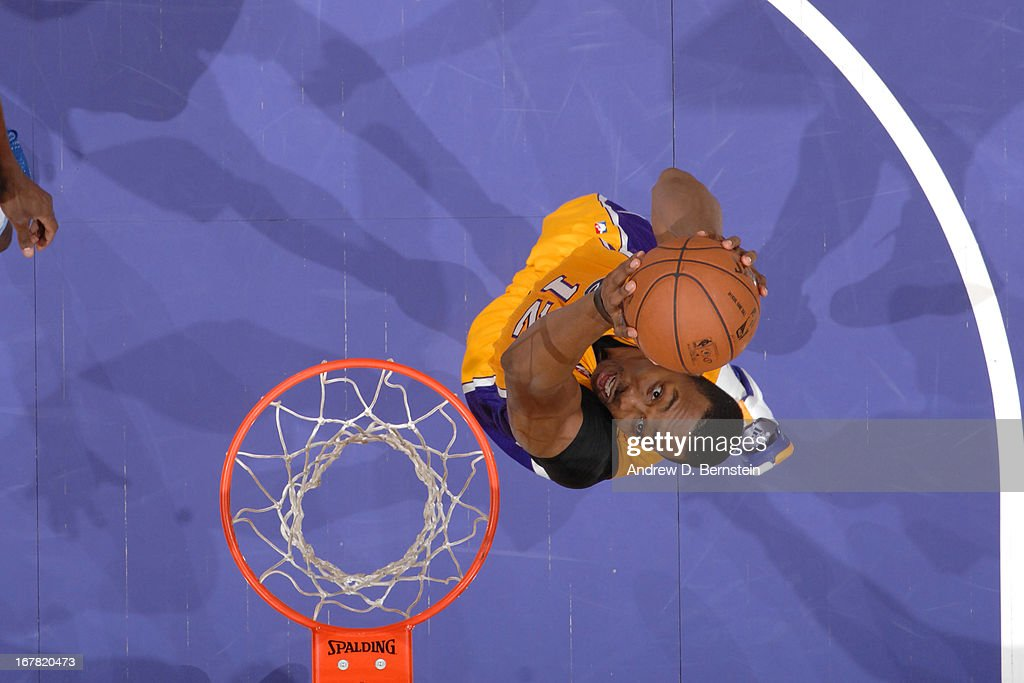 <a gi-track='captionPersonalityLinkClicked' href=/galleries/search?phrase=Dwight+Howard&family=editorial&specificpeople=201570 ng-click='$event.stopPropagation()'>Dwight Howard</a> #12 of the Los Angeles Lakers dunks against the Memphis Grizzlies at Staples Center on April 5, 2013 in Los Angeles, California.