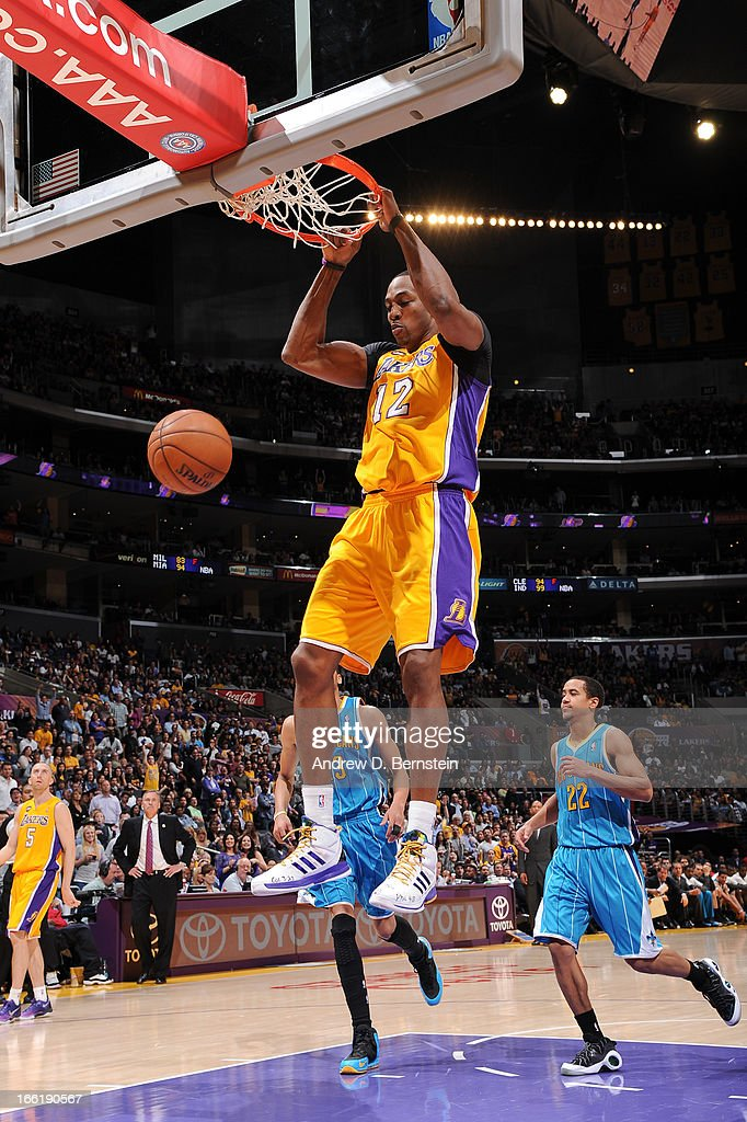 Dwight Howard #12 of the Los Angeles Lakers dunks against the New Orleans Hornets at Staples Center on April 9, 2013 in Los Angeles, California.