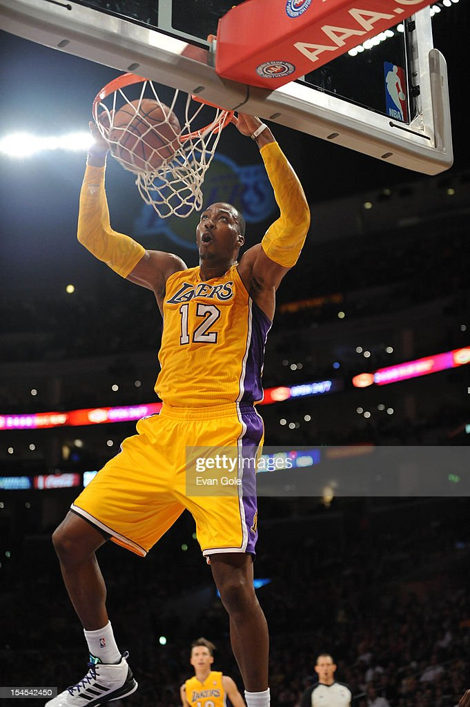 <a gi-track='captionPersonalityLinkClicked' href=/galleries/search?phrase=Dwight+Howard&family=editorial&specificpeople=201570 ng-click='$event.stopPropagation()'>Dwight Howard</a> #12 of the Los Angeles Lakers dunks against the Sacramento Kings during a pre-season game at Staples Center on October 21, 2012 in Los Angeles, California.