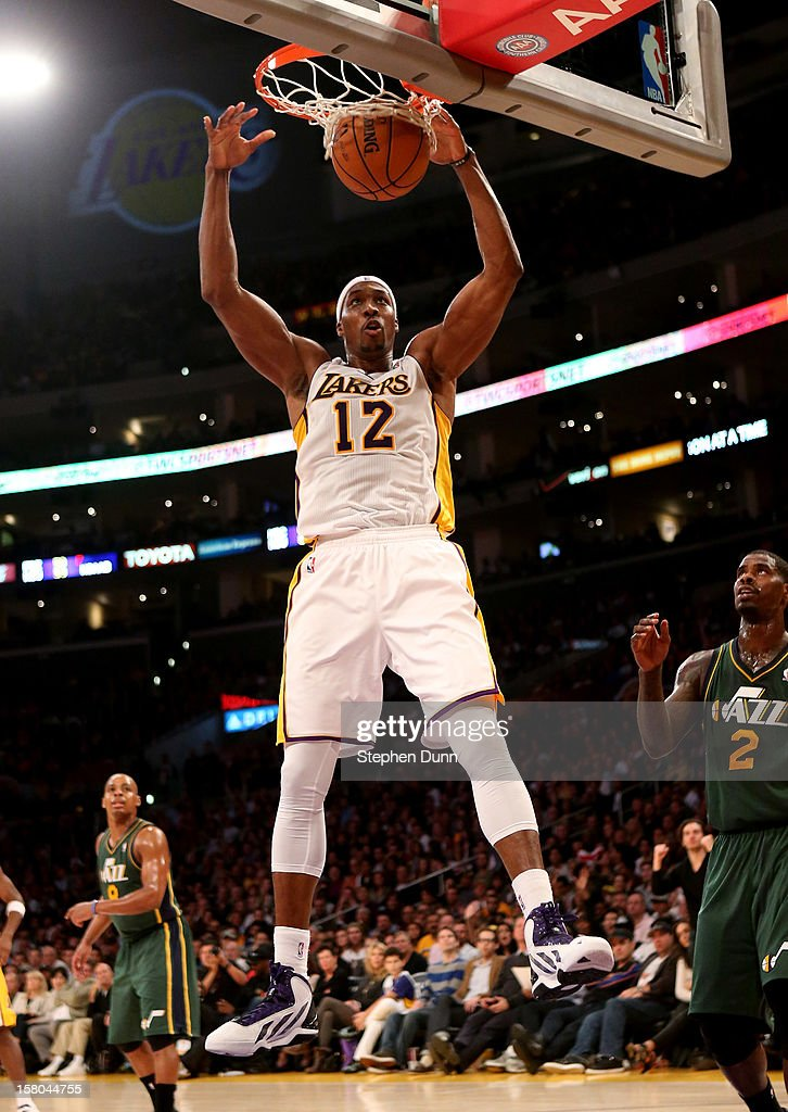Dwight Howard #12 of the Los Angeles Lakers dunks against the Utah Jazz at Staples Center on December 9, 2012 in Los Angeles, California. The Jazz won 117-110.