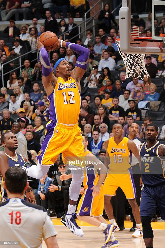 Dwight Howard #12 of the Los Angeles Lakers dunks against the Utah Jazz at Staples Center on January 25, 2013 in Los Angeles, California.