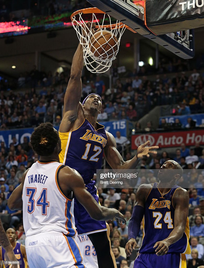 Dwight Howard #12 of the Los Angeles Lakers dunks over Hasheem Thabeet #34 of the Oklahoma City Thunder December 7, 2012 at Chesapeake Energy Arena in Oklahoma City, Oklahoma. Oklahoma City defeated Los Angeles 114-108.