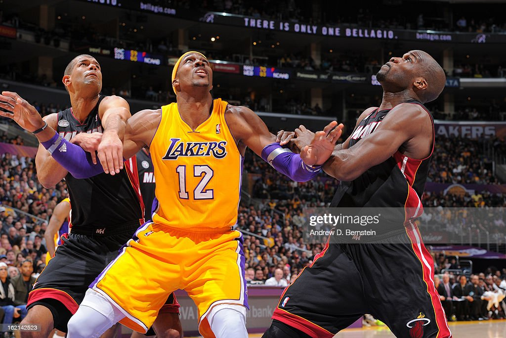Dwight Howard #12 of the Los Angeles Lakers fights for position against Shane Battier #31 and Joel Anthony #50 of the Miami Heat at Staples Center on January 17, 2013 in Los Angeles, California.