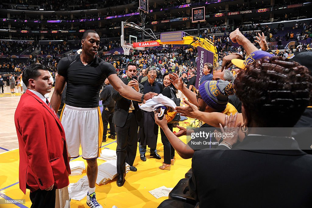 <a gi-track='captionPersonalityLinkClicked' href=/galleries/search?phrase=Dwight+Howard&family=editorial&specificpeople=201570 ng-click='$event.stopPropagation()'>Dwight Howard</a> #12 of the Los Angeles Lakers gives his jersey to a fan following his team's victory against the Sacramento Kings at Staples Center on March 17, 2013 in Los Angeles, California.