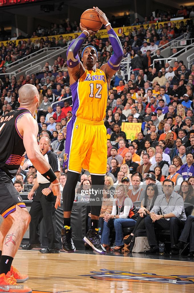 Dwight Howard #12 of the Los Angeles Lakers goes for a jump shot during the game between the Los Angeles Lakers and the Phoenix Suns at US Airways Center on January 30, 2013 in Phoenix, Arizona.