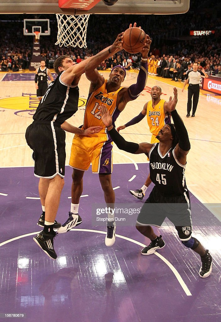 <a gi-track='captionPersonalityLinkClicked' href=/galleries/search?phrase=Dwight+Howard&family=editorial&specificpeople=201570 ng-click='$event.stopPropagation()'>Dwight Howard</a> #12 of the Los Angeles Lakers goes for a rebound against <a gi-track='captionPersonalityLinkClicked' href=/galleries/search?phrase=Brook+Lopez&family=editorial&specificpeople=3847328 ng-click='$event.stopPropagation()'>Brook Lopez</a> #11 and Gerald Wallace #45 of the Brooklyn Nets at Staples Center on November 20, 2012 in Los Angeles, California. The Lakers won 95-90.