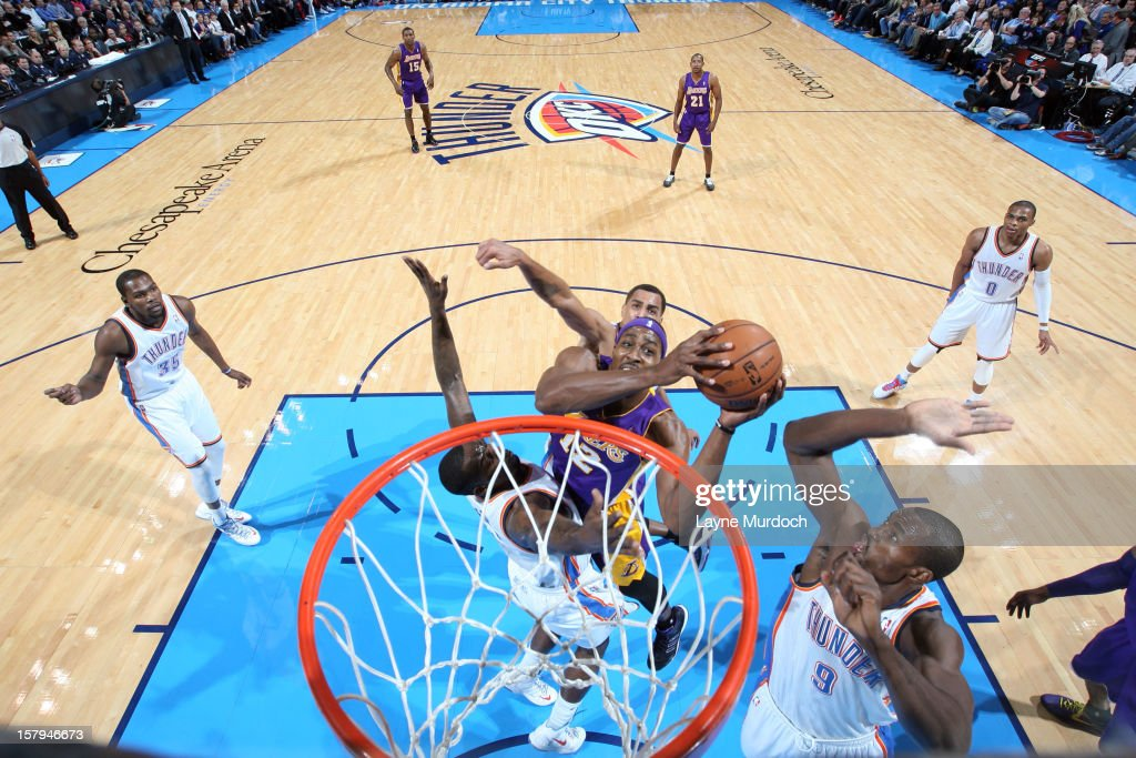 Dwight Howard #12 of the Los Angeles Lakers goes up for the basket inbetween traffic against the Oklahoma City Thunder during an NBA game on December 7, 2012 at the Chesapeake Energy Arena in Oklahoma City, Oklahoma.