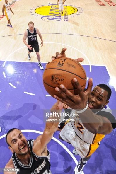 Dwight Howard of the Los Angeles Lakers grabs a rebound against Manu Ginobili of the San Antonio Spurs in Game Four of the Western Conference...