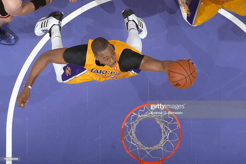 Dwight Howard #12 of the Los Angeles Lakers grabs a rebound against the Phoenix Suns at Staples Center on February 12, 2013 in Los Angeles, California.