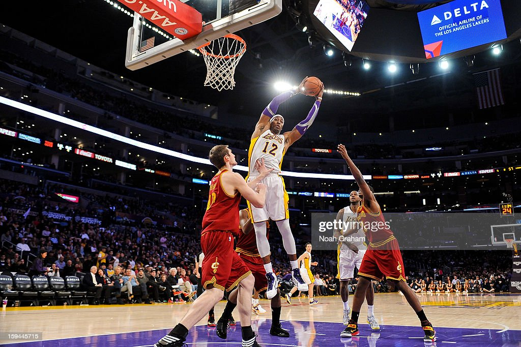 <a gi-track='captionPersonalityLinkClicked' href=/galleries/search?phrase=Dwight+Howard&family=editorial&specificpeople=201570 ng-click='$event.stopPropagation()'>Dwight Howard</a> #12 of the Los Angeles Lakers grabs a rebound against <a gi-track='captionPersonalityLinkClicked' href=/galleries/search?phrase=Tyler+Zeller&family=editorial&specificpeople=5122156 ng-click='$event.stopPropagation()'>Tyler Zeller</a> #40 of the Cleveland Cavaliers at Staples Center on January 13, 2013 in Los Angeles, California.
