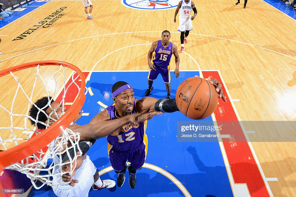 Dwight Howard #12 of the Los Angeles Lakers grabs the rebound against Nick Young #1 of the Philadelphia 76ers on December 16, 2012 at the Wells Fargo Center in Philadelphia, Pennsylvania.