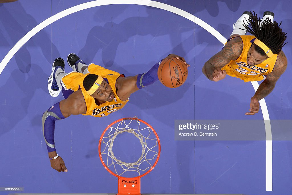 <a gi-track='captionPersonalityLinkClicked' href=/galleries/search?phrase=Dwight+Howard&family=editorial&specificpeople=201570 ng-click='$event.stopPropagation()'>Dwight Howard</a> #12 of the Los Angeles Lakers grabs the rebound against the Philadelphia 76ers at Staples Center on January 1, 2013 in Los Angeles, California.