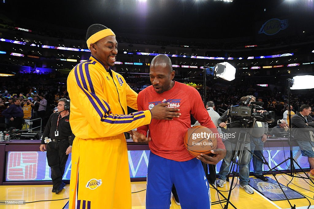 Dwight Howard #12 of the Los Angeles Lakers greets Jason Richardson #23 of the Philadelphia 76ers during the game between the Philadelphia 76ers and the Los Angeles Lakers at Staples Center on January 1, 2013 in Los Angeles, California.
