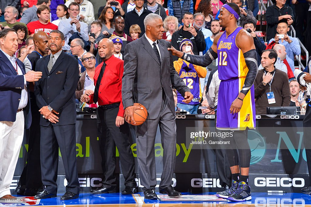 Dwight Howard #12 of the Los Angeles Lakers greets NBA legend Julius Erving before playing against the Philadelphia 76ers at the Wells Fargo Center on December 16, 2012 in Philadelphia, Pennsylvania.