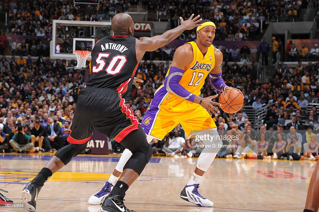 <a gi-track='captionPersonalityLinkClicked' href=/galleries/search?phrase=Dwight+Howard&family=editorial&specificpeople=201570 ng-click='$event.stopPropagation()'>Dwight Howard</a> #12 of the Los Angeles Lakers handles the ball against <a gi-track='captionPersonalityLinkClicked' href=/galleries/search?phrase=Joel+Anthony&family=editorial&specificpeople=4092295 ng-click='$event.stopPropagation()'>Joel Anthony</a> #50 of the Miami Heat at Staples Center on January 17, 2013 in Los Angeles, California.