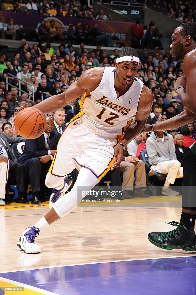 Dwight Howard #12 of the Los Angeles Lakers handles the ball against the Utah Jazz at Staples Center on December 9, 2012 in Los Angeles, California.