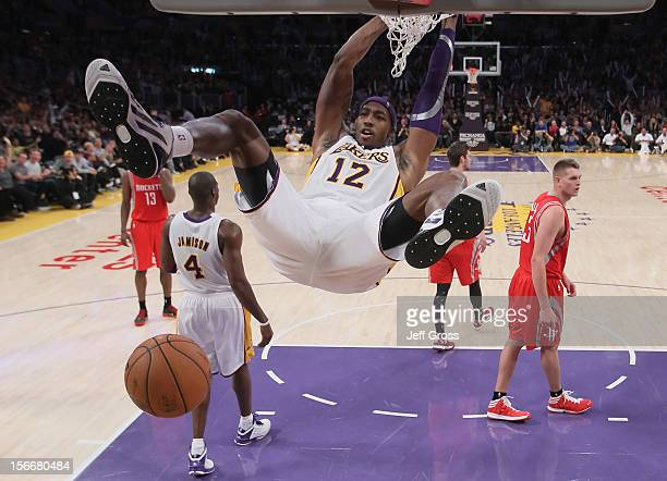 Dwight Howard of the Los Angeles Lakers hangs on the rim after a dunk against the Houston Rockets in the second half at Staples Center on November 18...