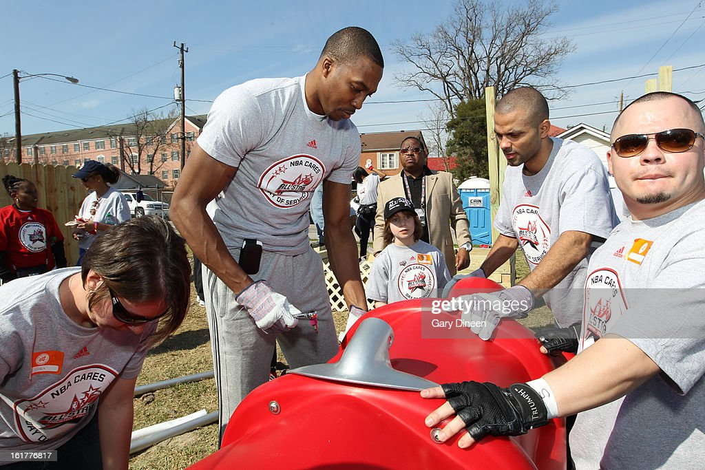 Dwight Howard #12 of the Los Angeles Lakers helps Tony Parker #9 of the San Antonio Spurs put together a playset at the 2013 NBA Cares Day of Service at the Playground Build with KaBOOM! on February 15, 2013 in Houston, Texas.
