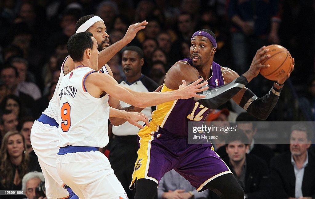Dwight Howard #12 of the Los Angeles Lakers in action against Rasheed Wallace #36 and Pablo Prigioni #9 of the New York Knicks at Madison Square Garden on December 13, 2012 in New York City. The Knicks defeated the Lakers 116-107.