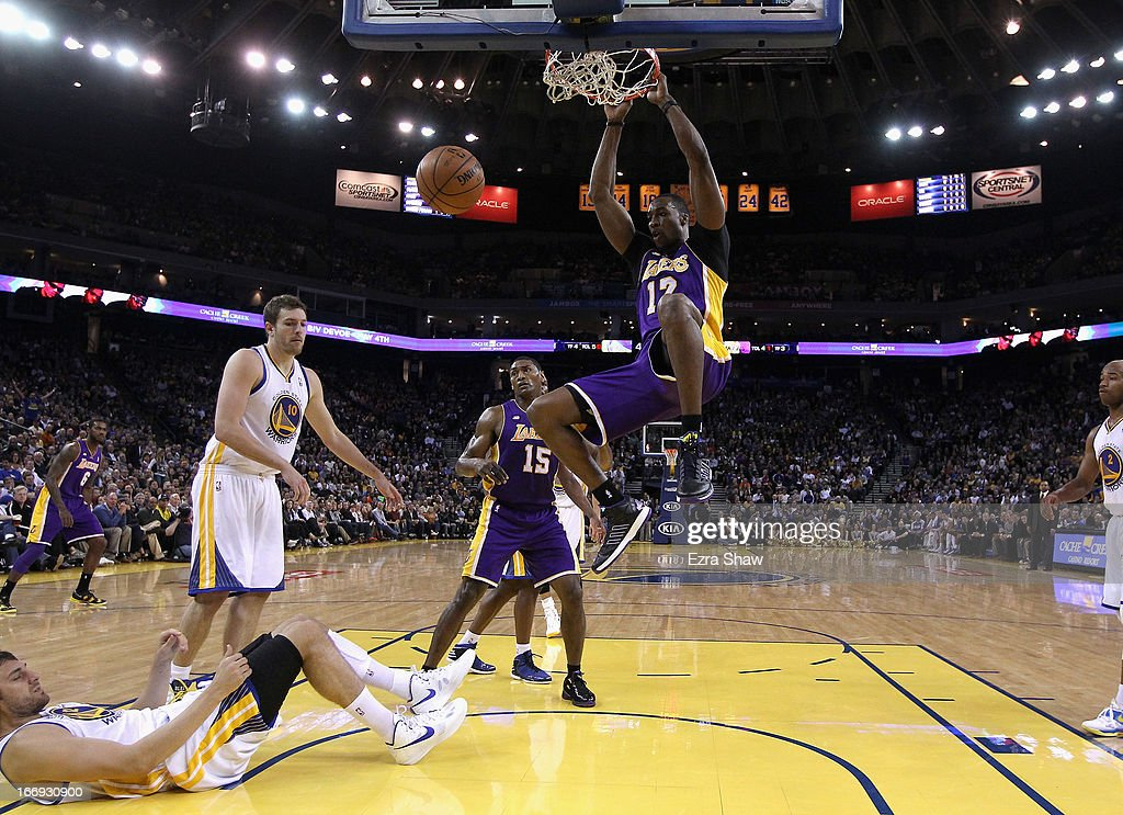 <a gi-track='captionPersonalityLinkClicked' href=/galleries/search?phrase=Dwight+Howard&family=editorial&specificpeople=201570 ng-click='$event.stopPropagation()'>Dwight Howard</a> #12 of the Los Angeles Lakers in action against the Golden State Warriors at Oracle Arena on March 25, 2013 in Oakland, California.