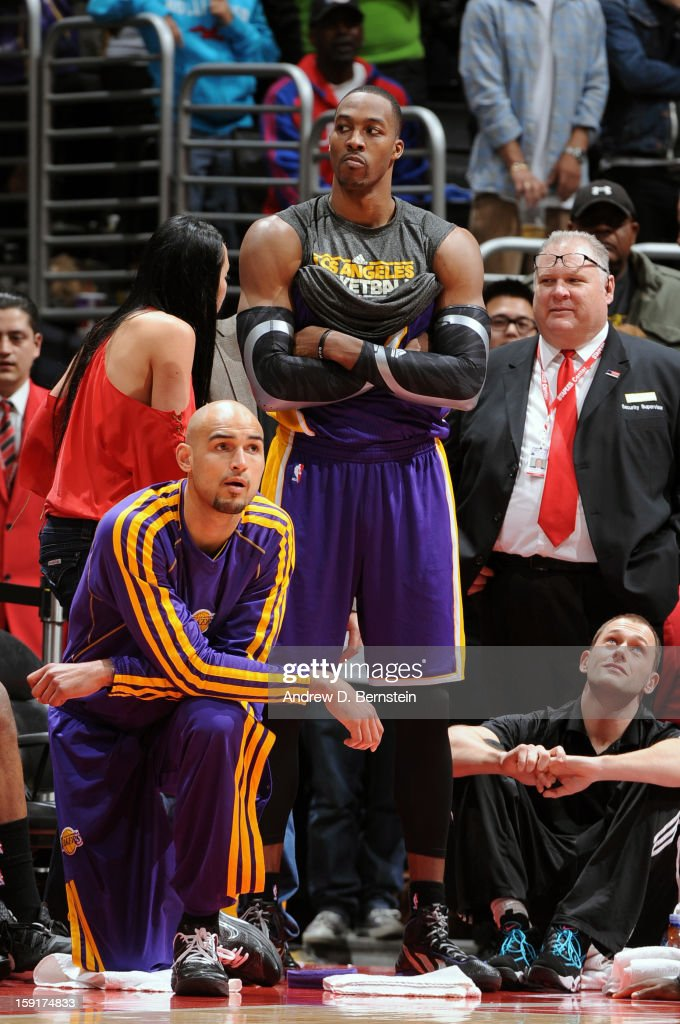 <a gi-track='captionPersonalityLinkClicked' href=/galleries/search?phrase=Dwight+Howard&family=editorial&specificpeople=201570 ng-click='$event.stopPropagation()'>Dwight Howard</a> #12 of the Los Angeles Lakers looks into the crowd while he is on the sidelines against the Los Angeles Clippers at Staples Center on January 4, 2013 in Los Angeles, California.